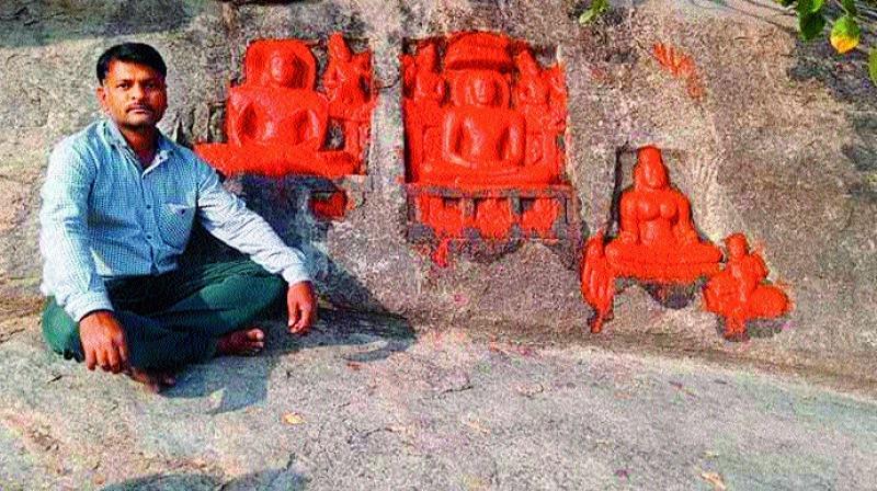 Historian Reddy Ratnakar Reddy with sculptures belonging to Jain Thirthankaras at Siddenki village.