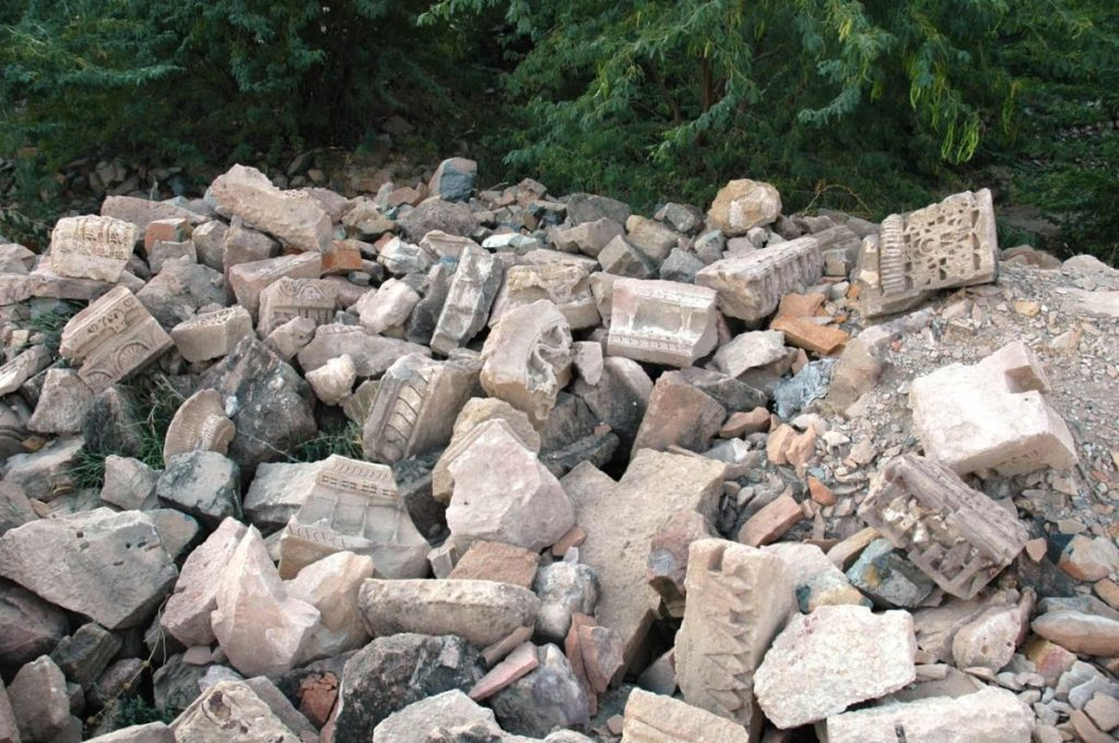 Stones from the ruins seen scattered and piled up at the temple complex.