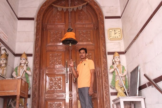 A caretaker of a Jain temple in New Delhi rings the bell for evening prayer. The Vatican sent greetings to Jains for their Mahavir Jayanti festival set for April 9.