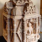 Chaturmukha Jain Tirthankara idol with Tirthankara seated in Padmasana, 10th- 11th Century.