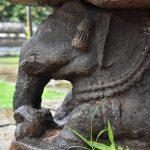 An Elephant being Carved along the base, Manastambha at Karkala, Udupi District, Karnataka.