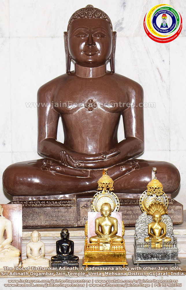 The idol of Tirthankar Adinath in padmasana along with other Jain idols, Sri Adinath DigambarJain Temple, Mehsana District, Gujarat, India.